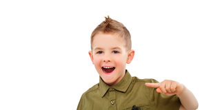 Portrait of attractive laughing boy, pointing finger Stock Images