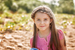 Portrait of attractive little girl in park Stock Image