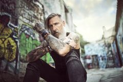 Portrait of an attractive man with a beard and tattoos stock photo