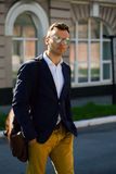 Portrait of attractive man with casual clothes walk in Europe.. Street photo Stock Photography
