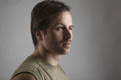 Portrait of an attractive man with green shirt Stock Photography