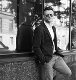 Portrait of attractive man standing near the store. Street photo Royalty Free Stock Image