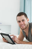 Portrait of an attractive man using a tablet computer  Royalty Free Stock Images