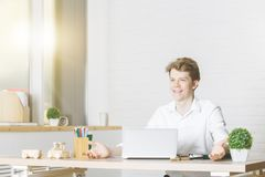 Portrait of attractive man at workplace stock photography