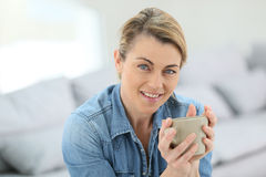 Portrait of attractive mature blond woman with cup of coffee Stock Photo