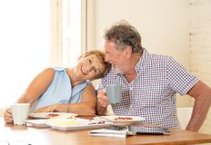 Portrait of a beautiful senior couple having breakfast together. Portrait of a attractive mature retired couple having breakfast together at home enjoying the Royalty Free Stock Photo