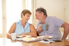 Portrait of a beautiful senior couple having breakfast together. Portrait of a attractive mature retired couple having breakfast together at home enjoying the Royalty Free Stock Images