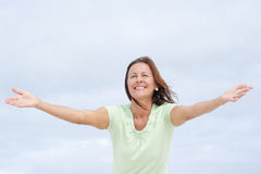 Positive mature woman open arms Royalty Free Stock Photos