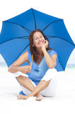 Happy Mature woman blue umbrella beach Stock Photography