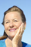 Portrait attractive mature woman  sky Royalty Free Stock Image