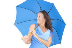 Confident attractive mature woman blue umbrella Royalty Free Stock Images