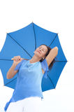 Relaxed attractive mature woman blue umbrella Royalty Free Stock Images