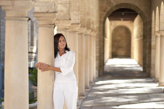 Attractive romantic mature woman archway pillar Stock Photo