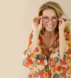 Portrait of attractive mature woman wearing eyeglasses. Portrait of attractive trendy woman with eyeglasses, isolated Stock Photo