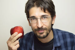 Portrait of attractive man smiling with red apple, healthy fruit.  Stock Photos