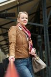 Portrait of an attractive middle aged woman standing outside Stock Images