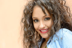 Attractive mixed woman in urban background wearing casual clothe Stock Photo