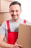 Portrait of attractive mover guy holding cardboard box Royalty Free Stock Image