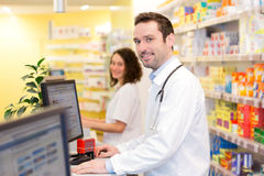 Portrait of an attractive pharmacist team at work Stock Photos