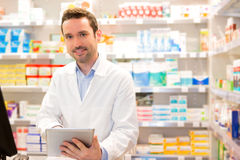 Portrait of an attractive pharmacist at work Royalty Free Stock Images