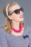 Portrait of attractive pinup girl in sunglasses Royalty Free Stock Photography
