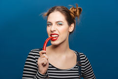 Portrait of attractive pretty young woman with chilli pepper Stock Image