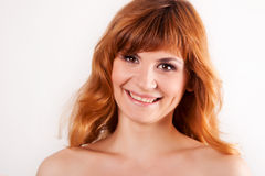 Portrait of attractive red haired young woman Stock Image