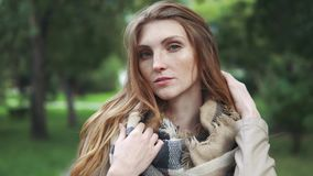 Portrait of an attractive redhead with lots of freckles on the face. 20s. Closeup portrait of a beautiful red-haired girl. hair fluttering in the wind. girl with stock video footage