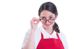 Portrait of attractive retailer looking over glasses. With a confident attitude isolated on white Royalty Free Stock Photos