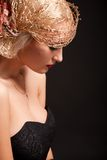Portrait of attractive retro-style woman in bonnet. Over black Royalty Free Stock Photos