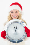 Portrait of attractive santa woman holding clock Stock Images