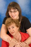 Portrait of attractive senior woman with daughter. Happy family portrait of young woman hugging her mother Stock Photos