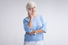 Portrait of attractive senior woman with mobile phone. Stock Images