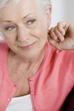A portrait of an attractive senior woman, relaxing Stock Images