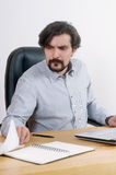 Portrait of attractive serious businessman working with document Royalty Free Stock Images