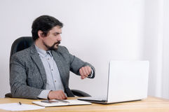 Portrait of attractive serious businessman working at his desk Stock Photos