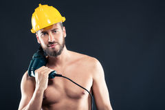 Portrait of attractive shirtless workman with drill Royalty Free Stock Photography