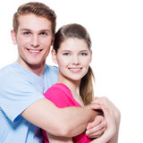 Portrait of attractive smiling couple. Portrait of attractive smiling couple isolated on white background. Attractive men and women being playful royalty free stock photography