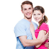 Portrait of attractive smiling couple. Portrait of attractive smiling couple isolated on white background. Attractive men and women being playful royalty free stock image