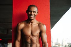 Portrait of an attractive smiling half naked african sportsman Stock Photo