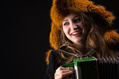 Portrait attractive smiling woman with fur hat Royalty Free Stock Image