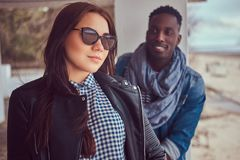 Portrait of an attractive stylish couple. African-American guy w. Portrait of an attractive stylish couple. An African-American men and Caucasian girl Stock Photo