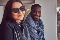 Portrait of an attractive stylish couple. African-American guy w royalty free stock photos