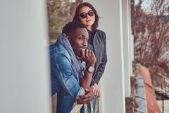 Portrait of an attractive stylish couple. African-American guy w royalty free stock photo