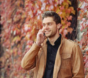 Portrait of attractive stylish young man speaking on the phone i Stock Image