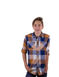 Portrait of attractive teen boy being photographed in a studio. Isolated on white background. Royalty Free Stock Photography