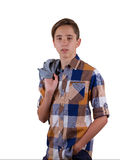 Portrait of attractive teen boy being photographed in a studio. Isolated on white background. Royalty Free Stock Photo