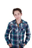 Portrait of attractive teen boy being photographed in a studio. Isolated on white background. Royalty Free Stock Images