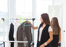 Portrait of attractive teen girl making choices clothes. At home Stock Photos