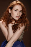 Portrait of attractive tender redhead woman posing for studio shot Royalty Free Stock Images